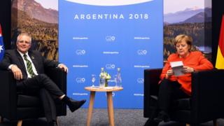 German Chancellor Angela Merkel sits down with Australian PM Scott Morrison at the G20 Summit