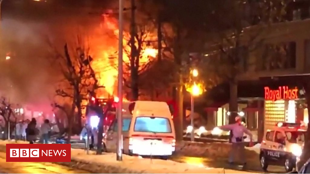 Japan explosion: Hearth and collapsed homes after blast