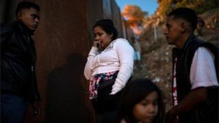 Migrants jump border fence in Tijuana to take a look at to reach US