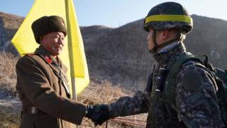 North and South Korea infantrymen pass DMZ in peace