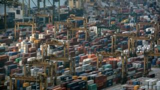 Truck drivers face jail in Singapore for $1 bribes