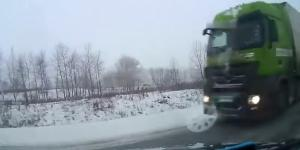 Vehicle jammed by trucks in Russia rolled over